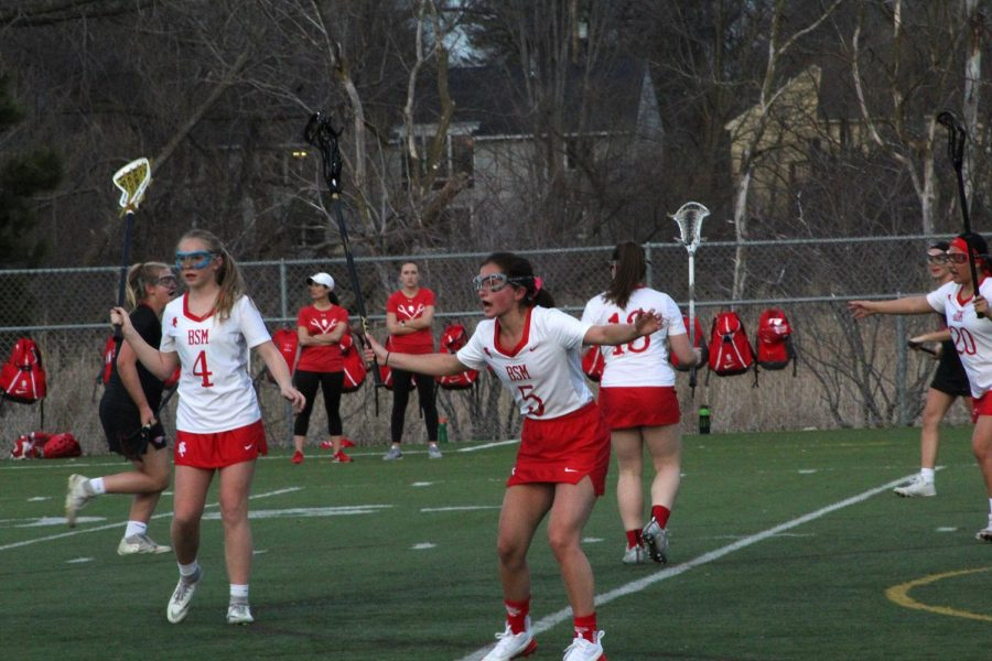 Senior Sally Calengor reacts on the lacrosse field to a play. Many sports will be affected by the new section change.