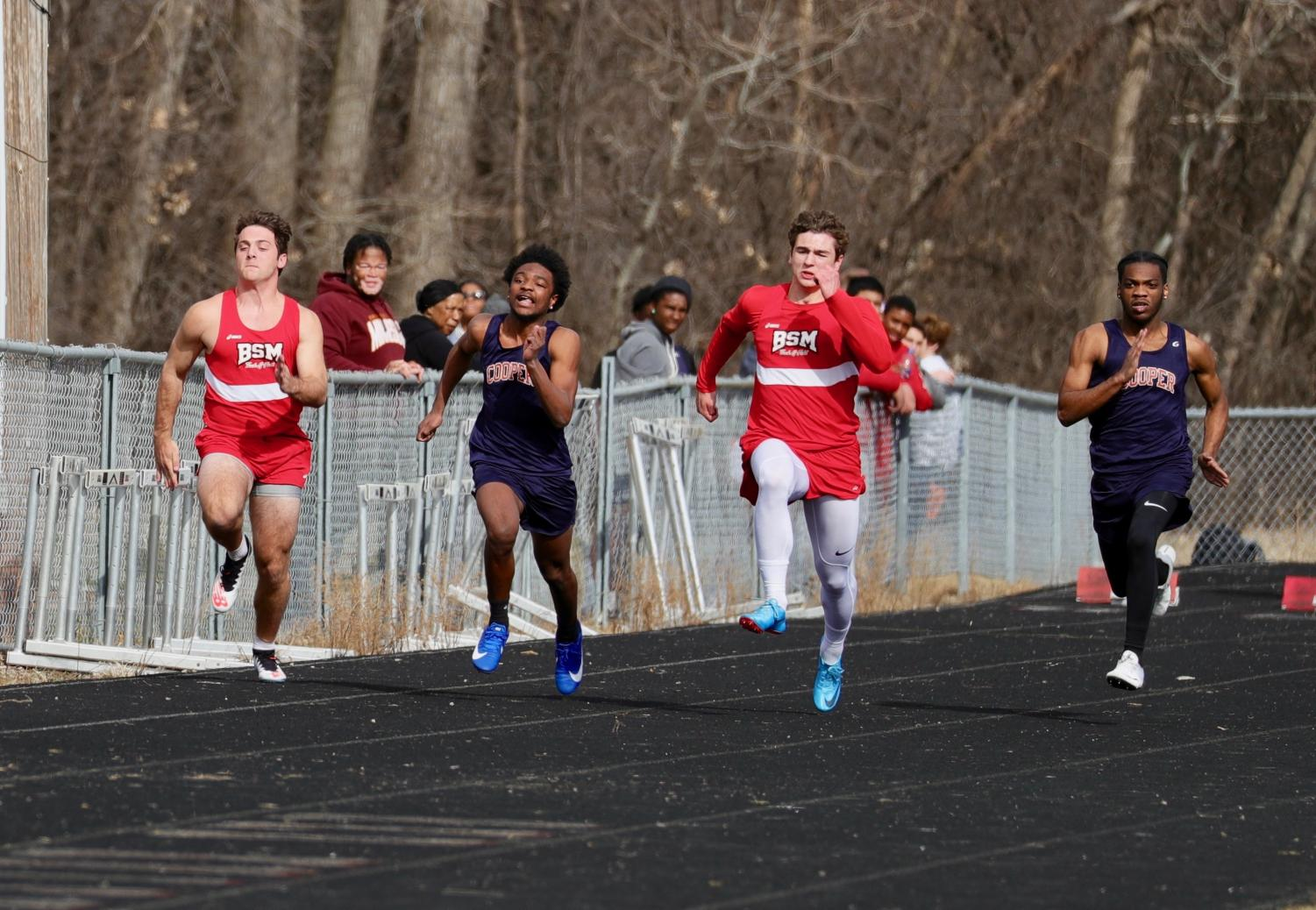 BSM Red Knights sprint down the track during one of their first meets this season.