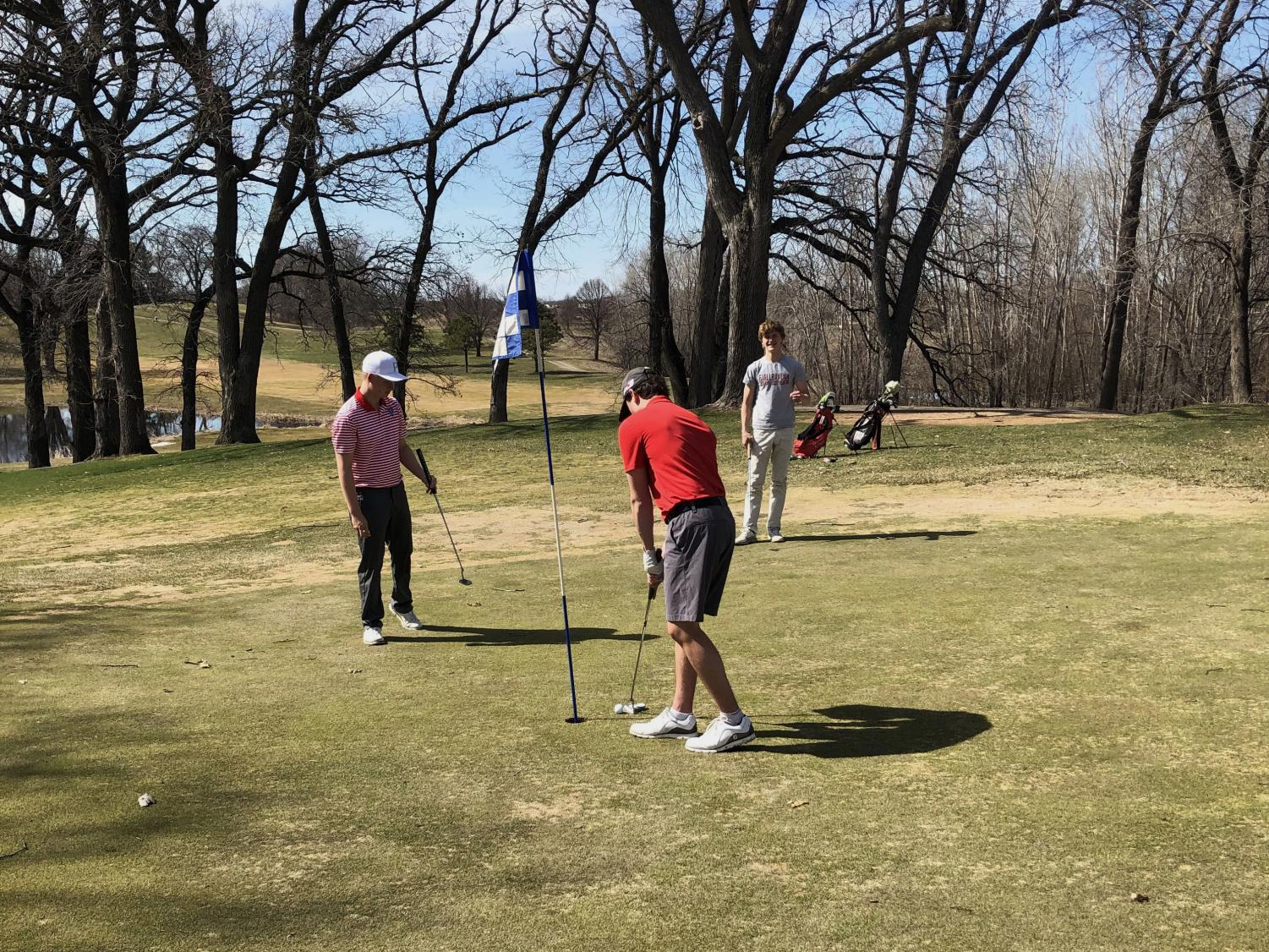BSM boys' golf practices their putting during early spring practices.
