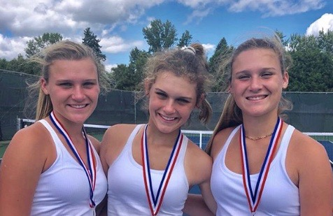 Brooke, Courtney, and Lauren Kallas celebrate the end of their tennis match.