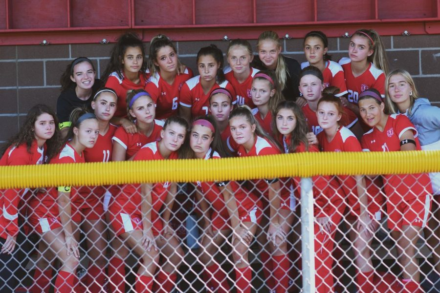 Girls+soccer+team+stand+together%2C+ready+for+their+game.