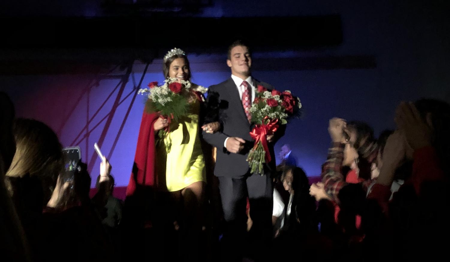 Seniors Joe Marinaro and Frida Fortier celebrate their selection as king and queen of this year's Homecoming Week.