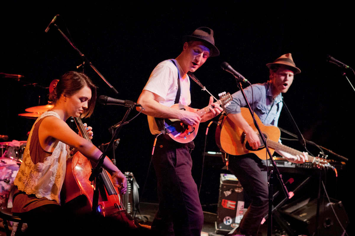 The Lumineers perform at Fairfield Theatre Company in Fairfield, Connecticut. Wesley Schultz on acoustic guitar (right), Jeremiah Fraites on mandolin (middle), Neyla Pekarek on cello (left). in 2012