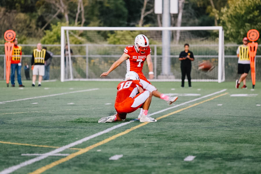Louis Hyde kicks the ball for an extra point during a BSM football game.