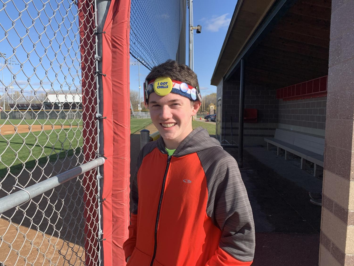Junior cross country runner Ryan Kraemer poses with his pin-decorated sweatband for Fun Hat Friday