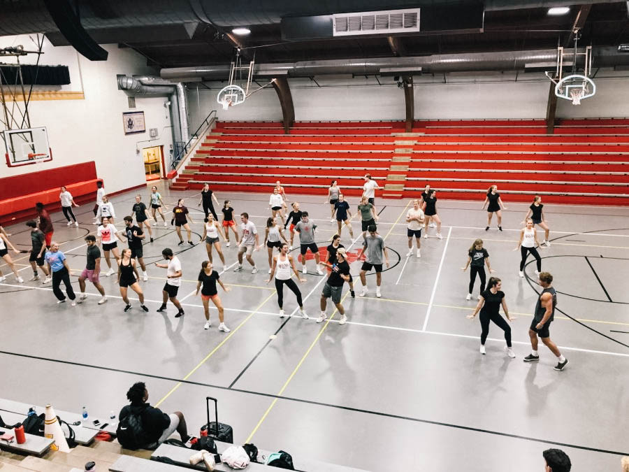 Knightettes and upperclassmen boys practice their routine for the pepfest.