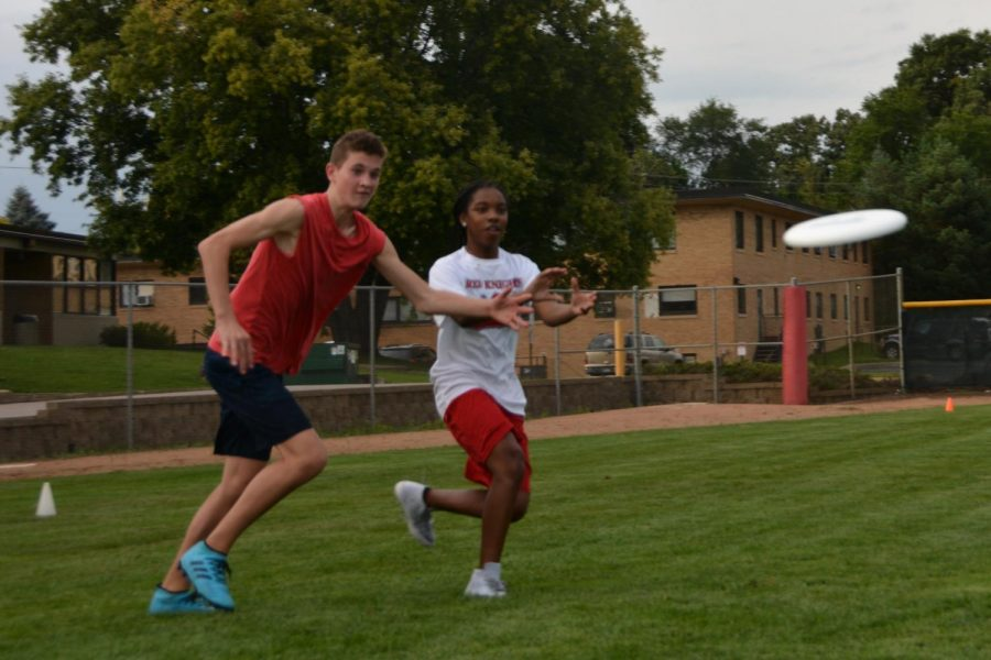 Spencer Plut and Tory Hatcher catch the disc at Ultimate practice. This year the team has add new teams.