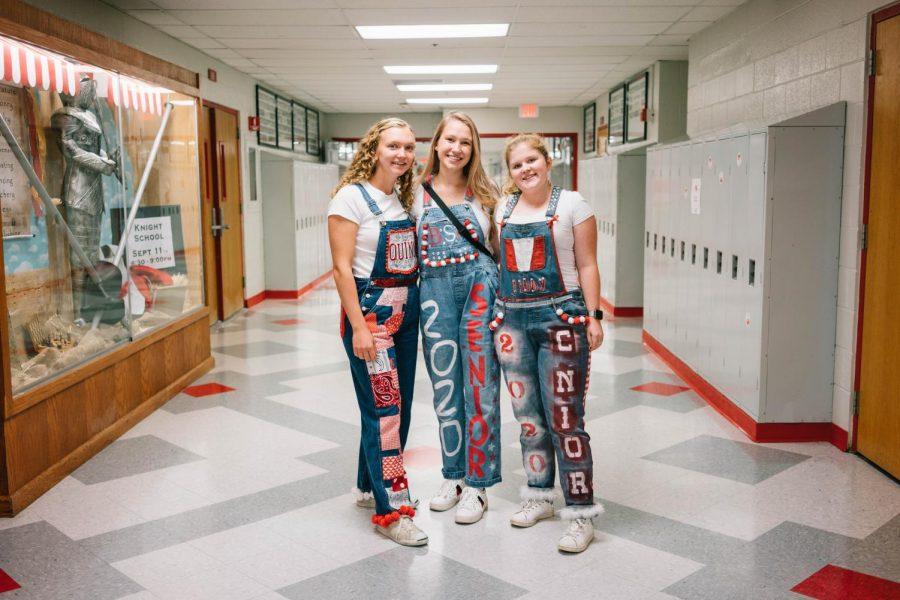 Seniors Quinn Elsenbast, Faith Niebergall, and Libby Simpson show off their overalls