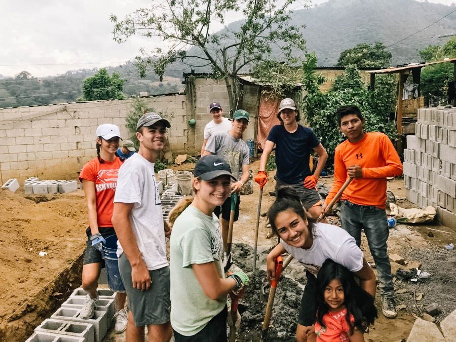 Kiara Herro, Matthew Nachbor, Claire Hennen, Grace Lira, Nic Dokman, Sam Decker, and Quinn Van Oort work together to help build a house for a Guatemalan family.