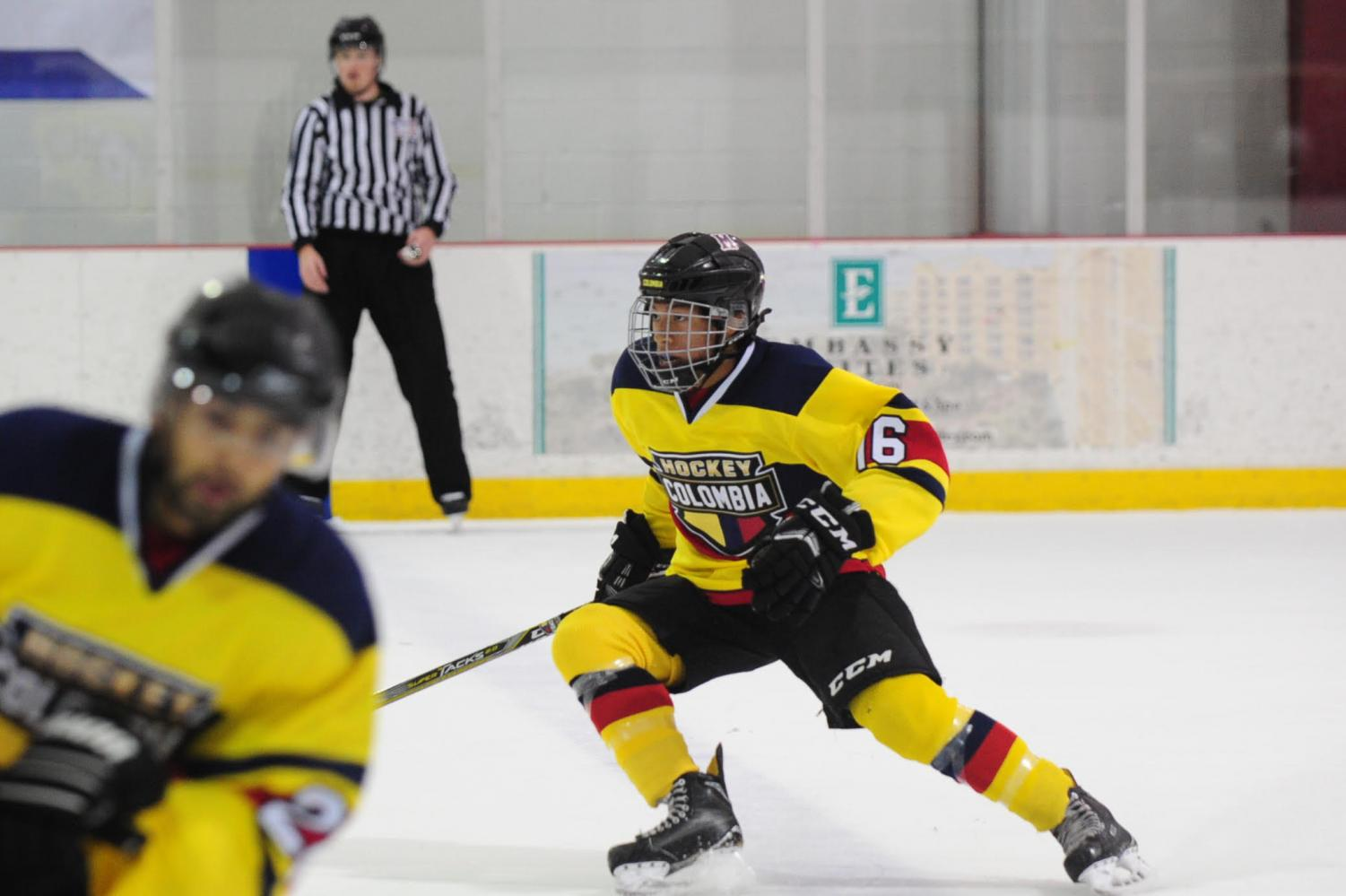Sophomore Leo Warner plays for the Columbian hockey team in a international competition.