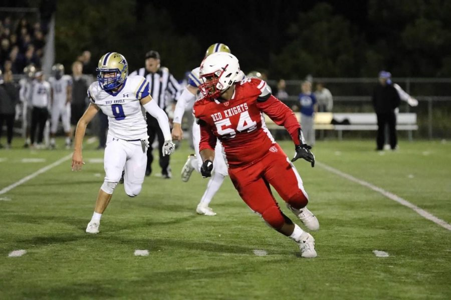 Senior nose guard Elijah Brown pulls to the outside to make a pancake block during the regular season. This weekend the team beings their run to State.