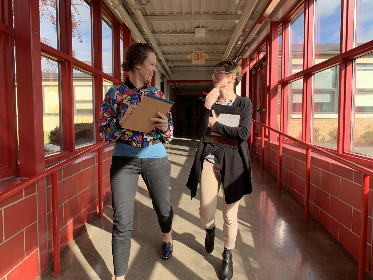 Ms. Overbo and Ms. Koshiol met for a walking meeting during wellness month.