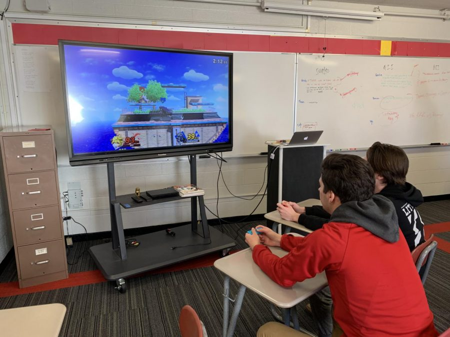 A+couple+of+students+play+Super+Smash+Bros.+The+new+esports+club+will+provide+a+casual+atmosphere+in+which+to+play+games+and+hangout.
