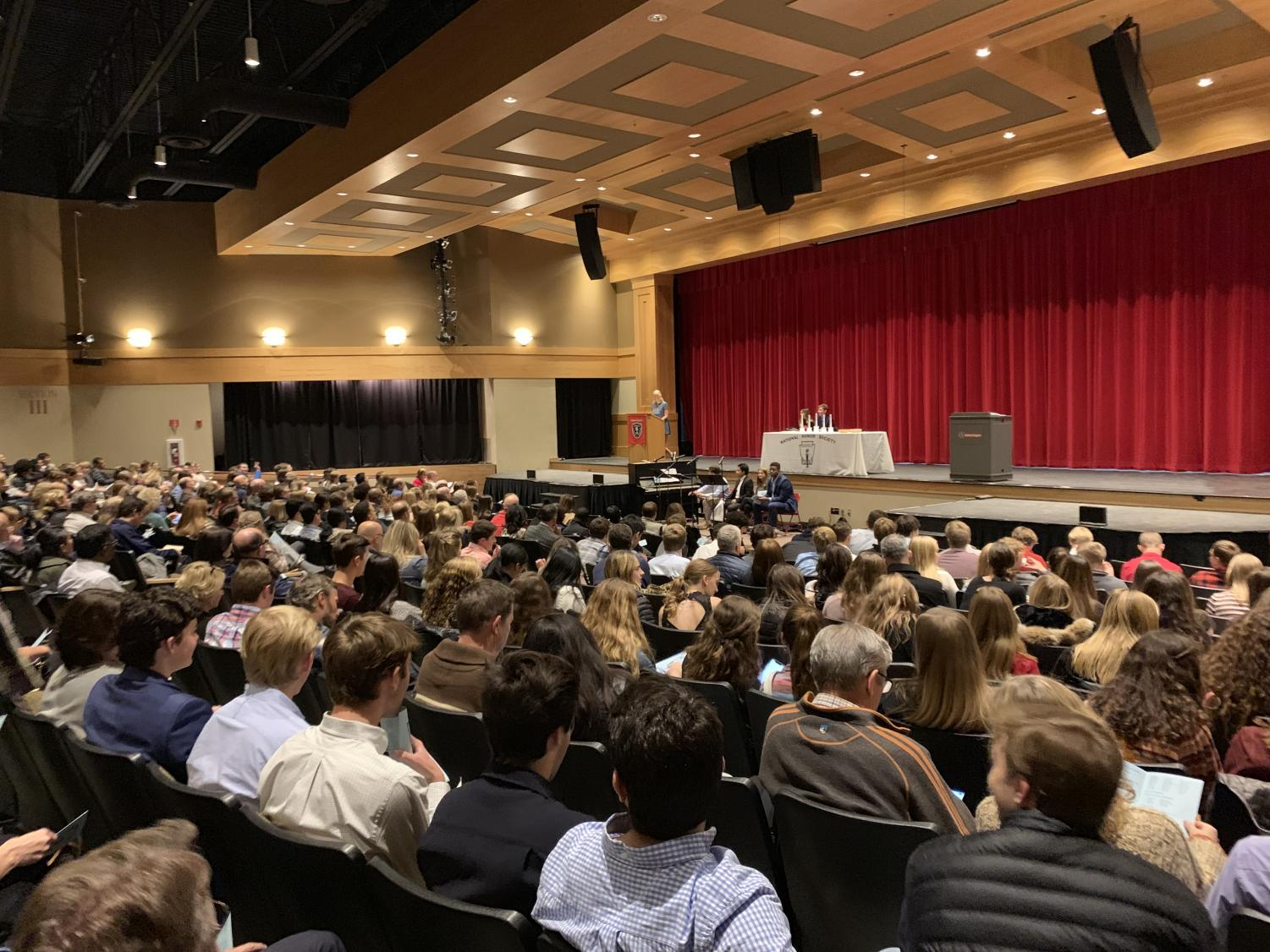 Parents and students gather to celebrate the induction of NHS members.