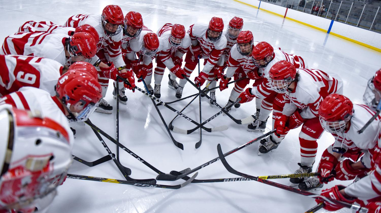 The boys' hockey team prepares for a game.