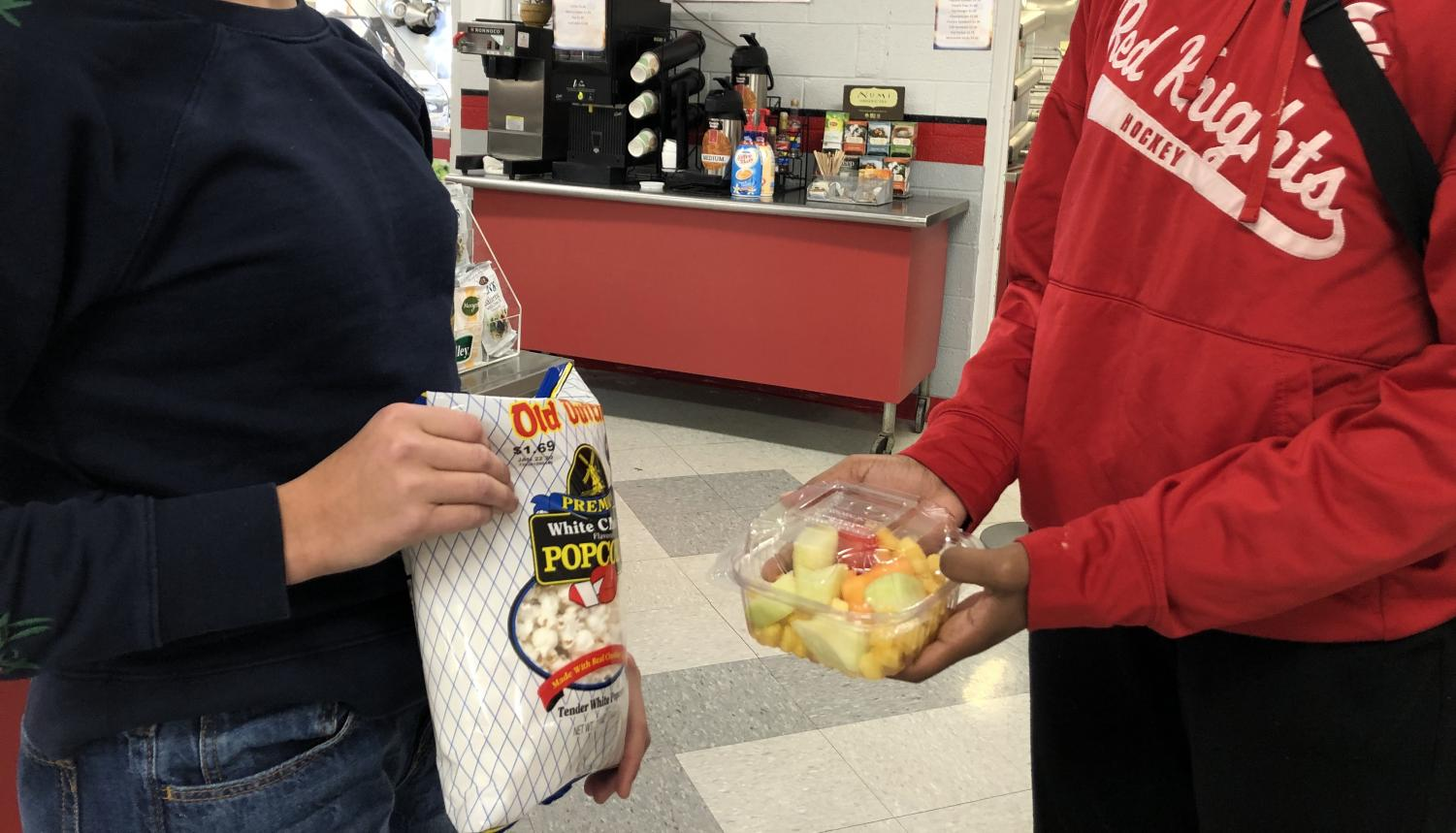 Students compare two different food options offered at Taher.