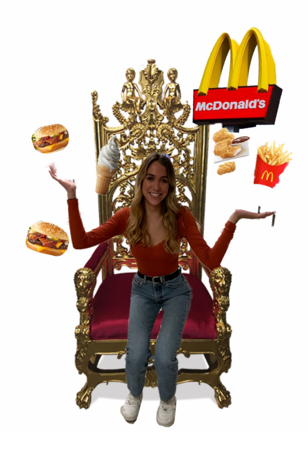 Sam+Richardson%2C+a+McDonald%27s+enthusiast%2C+sits+on+throne+of+burgers%2C+fries%2C+and+chicken+nuggets.+
