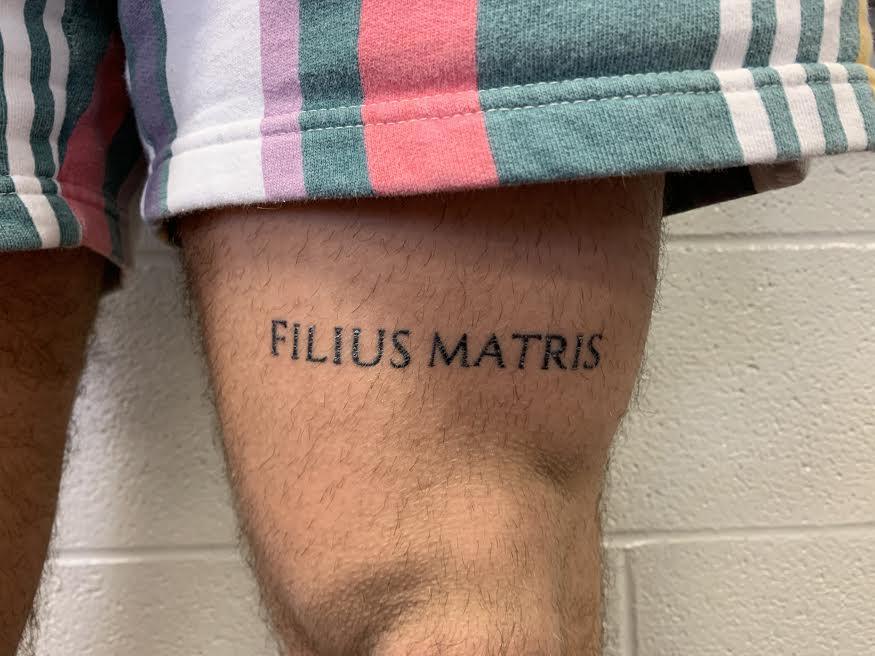 Luke+Mathwig%27s+tattoo+says%2C+%22Filius+Matris%22+which+is+a+Latin+phrase+which+translates+to+%E2%80%98Mother%E2%80%99s+son%E2%80%99.
