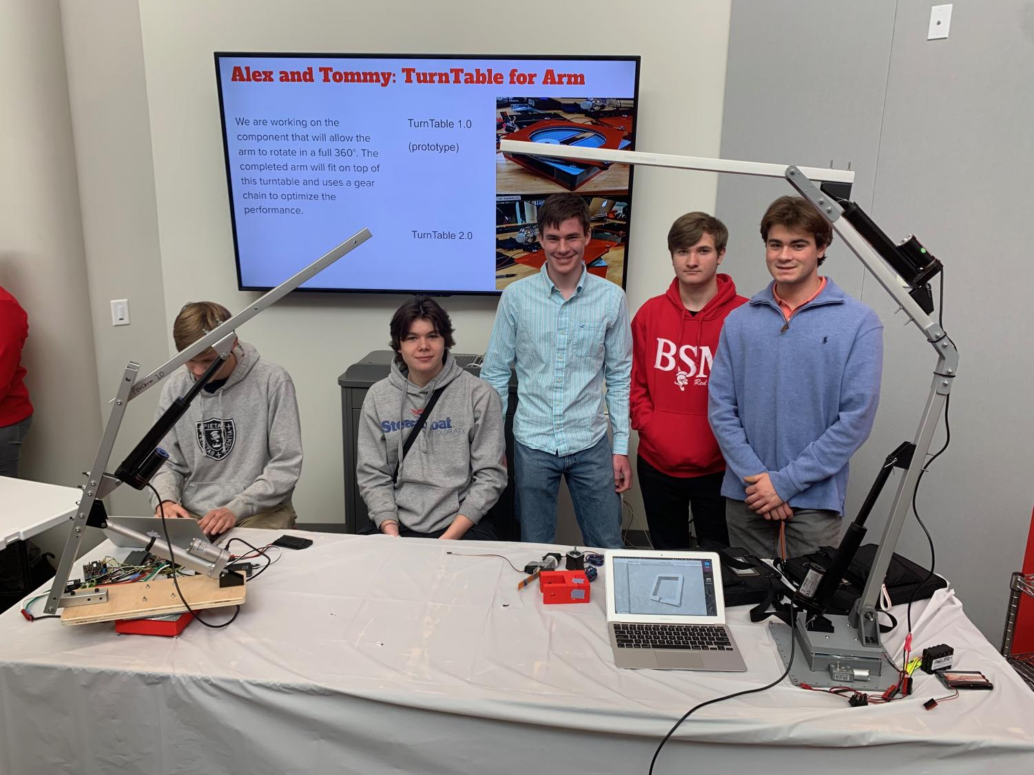 Students show off engineering designs.