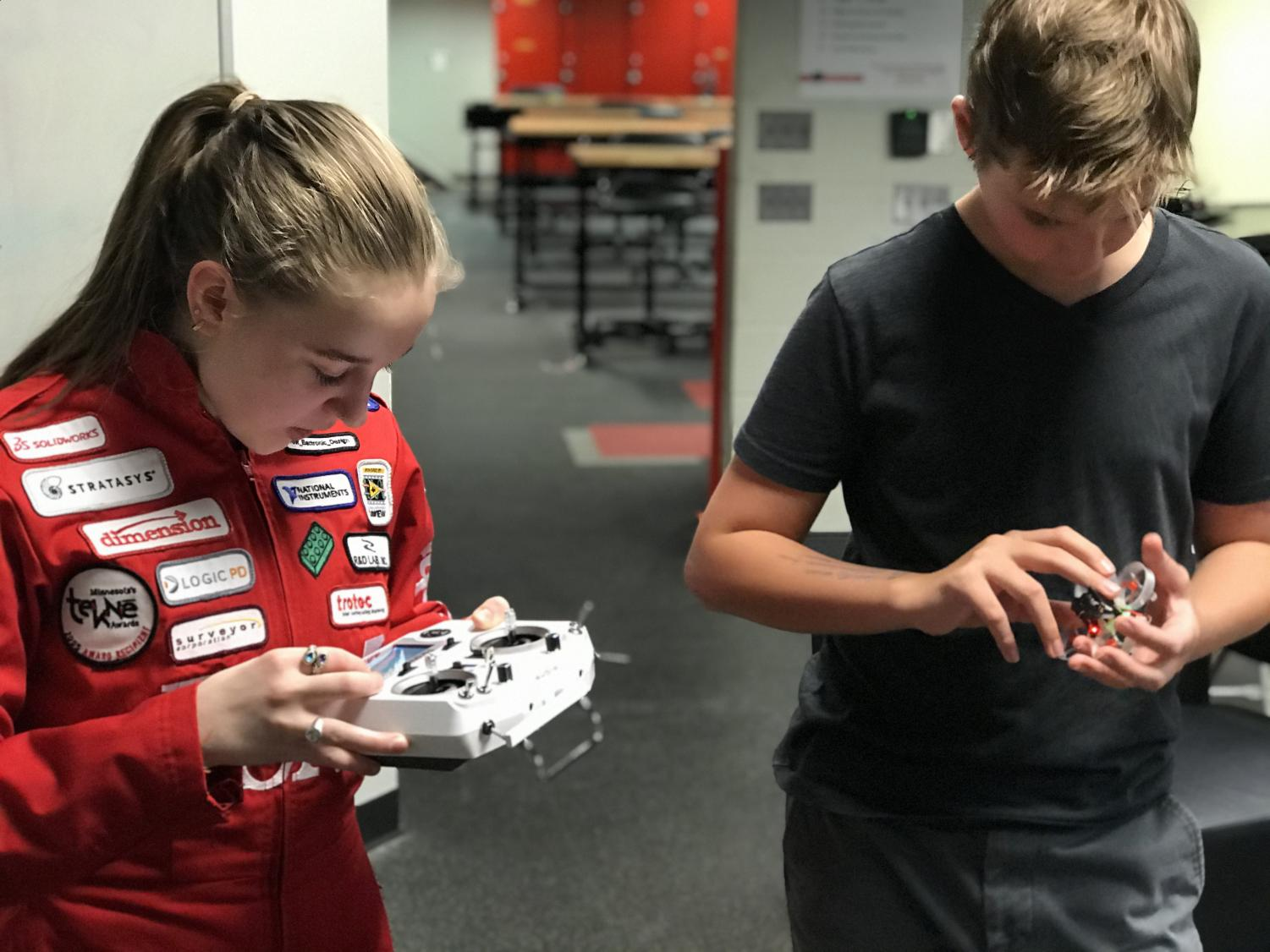 Junior Claire Larson and freshman Tommy Medina learn to control their drones.