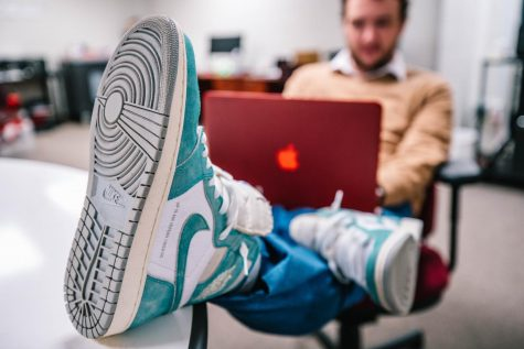 When students take their computer to the help desk, they can be sure to see tech support Bill Cheney rocking some sneakers.