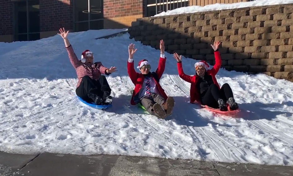 Three BSM administrators, Dr. Skinner, Dr. Ehrmantraut, and Mrs. Mortl show that you are never too old to go sledding.