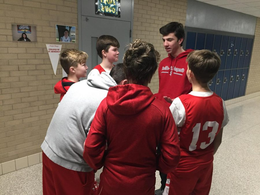 Joseph Pace talks to his team during the halftime of their game.