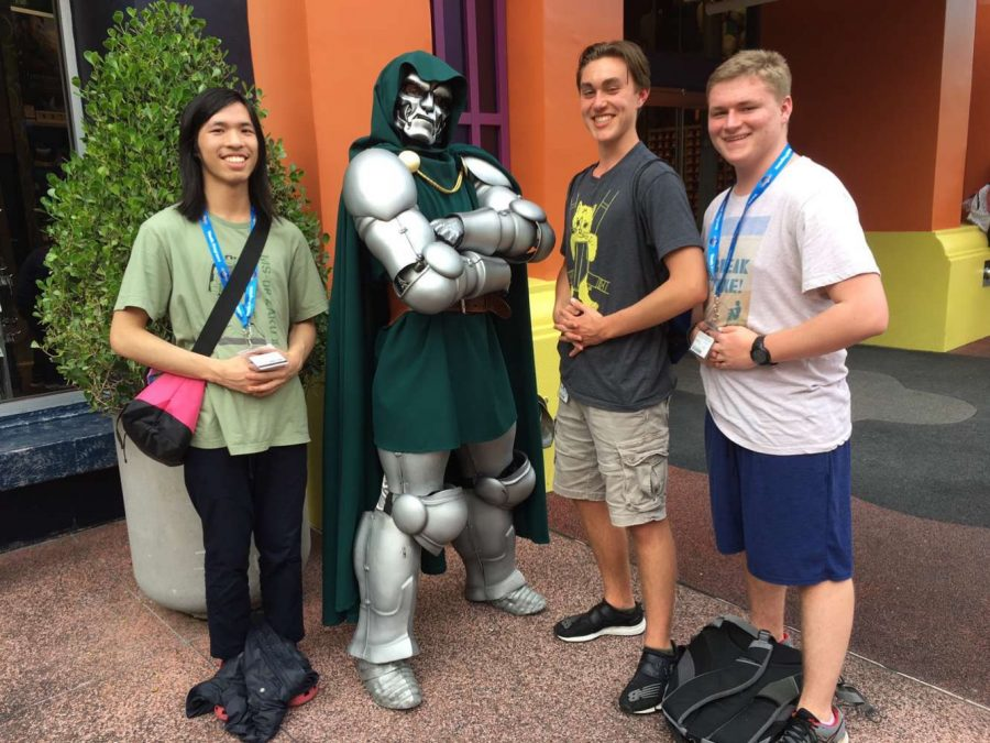 Seniors pose by a character on their trip.
