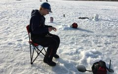 Ice Fishing: After drilling a hole and getting set up, it's all about the waiting.