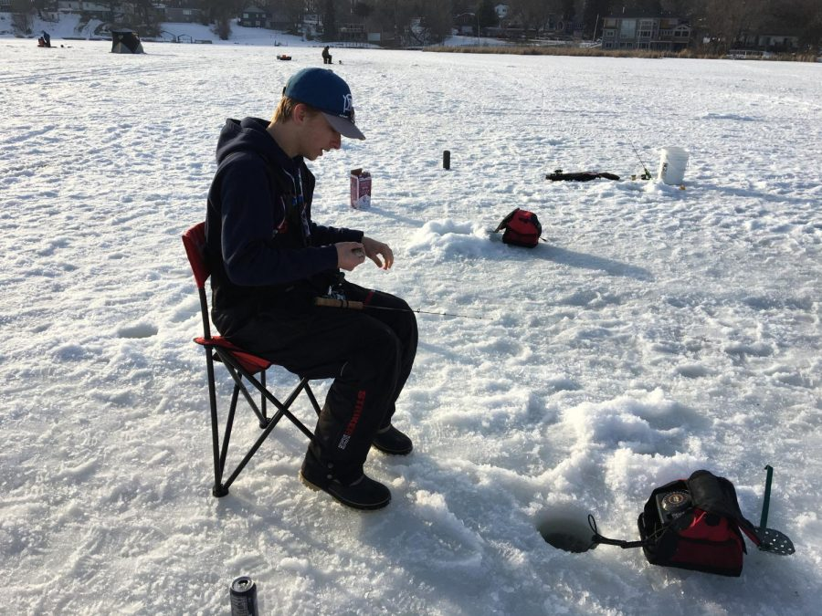 Ice Fishing: After drilling a hole and getting set up, it