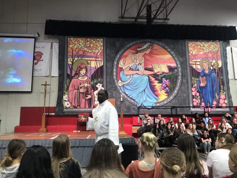 Deacon Doug leads prayer service for BSM students and teachers.