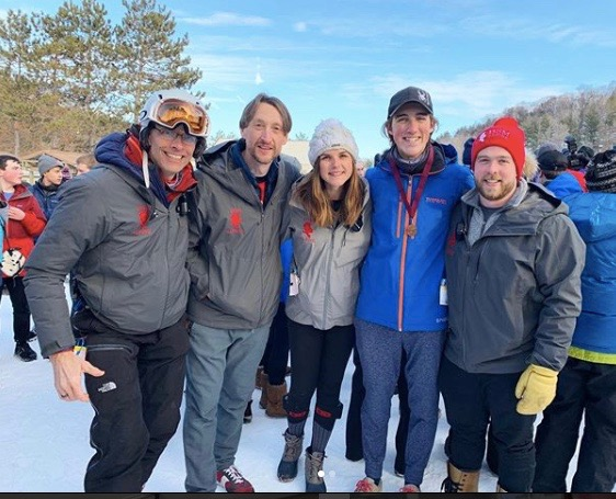 Davis Fortney and his coaches after a successful day of alpine.