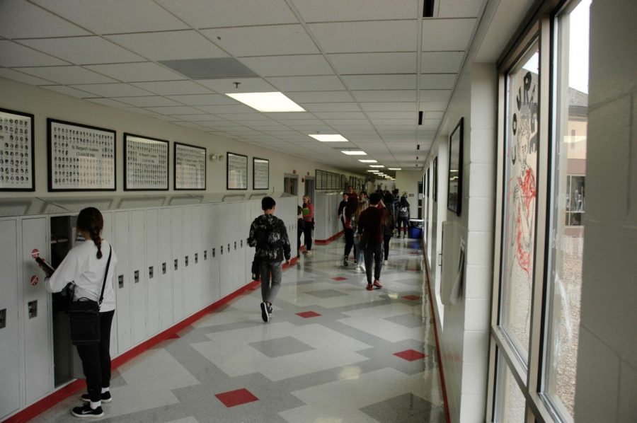 After utilizing the rather clever tactic of crowding around the door before the bell rings, these students made it into the hallway before the rush.