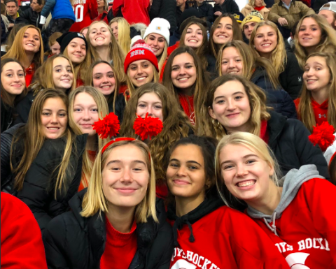 Seniors cheer on the hockey team before the pandemic closed schools.