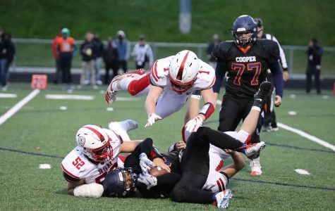 Senior captain George Wolfe dives over a tackle made by co-captain Nick Marinaro during the 2019 season. The team looks forward to making new memories together on the field this fall.