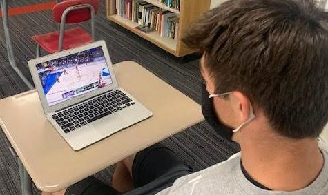 Junior Brady Wine watches NBA Bubble action between the LA Lakers and the Miami Heat in the NBA Finals.