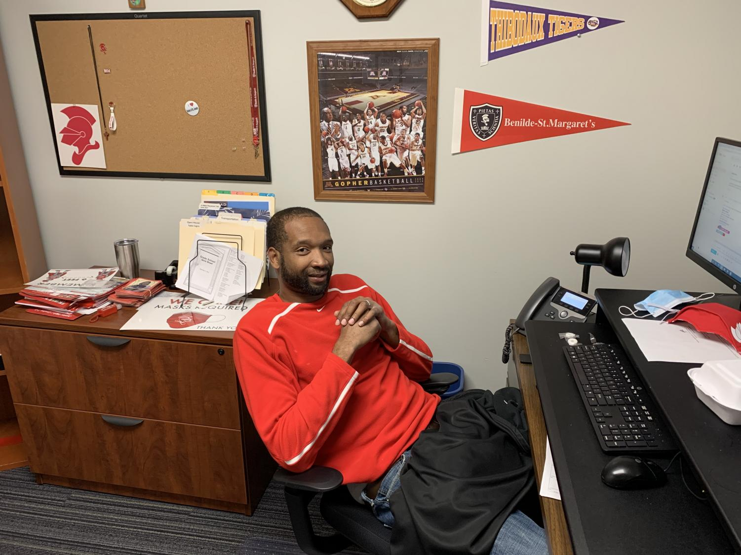 Mr. Damian Johnson spends his school days working in the Admissions Office and his nights coaching Red Knight basketball.