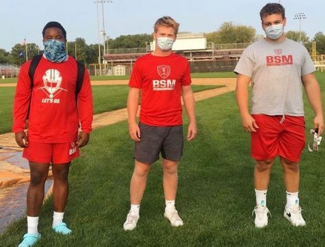 Senior football captains William Petty (left), George Wolfe (middle), and Nick Marinaro (Right) mask-up while preparing for the football season.