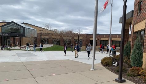 Cohort 2 students walk out of school at the end of their block day. Tomorrow they will be learning from home.