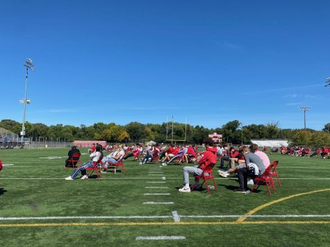 On the turf, seniors celebrate mass together on community day. Mass will be a part of each community day throughout the year.