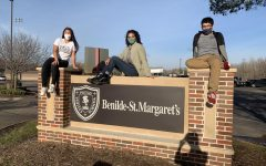 Seniors Xela Gunvalson, Sophie Coleman, and Johan Dominguez-Lopez sit atop the BSM sign.
