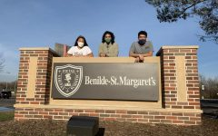 Seniors Xela Gunvalson, Sophie Coleman, and Johan Dominguez-Lopez pose on the BSM sign.