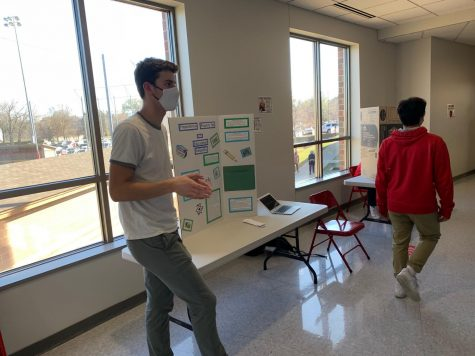 Senior Theo Pohlen presents his Justice Fair project on Education Inequality.