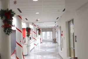 The space near the Atrium is festooned with garland and ribbon.