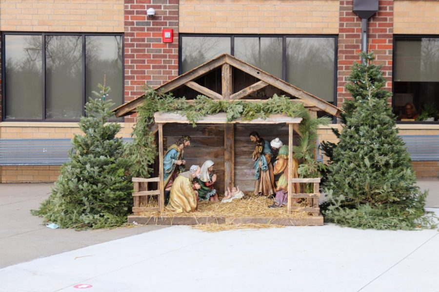 The manger welcomes students into the building.