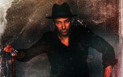 Tom Morello poses on the album cover for