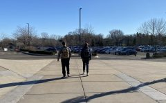 Seniors Nick Marinaro (left) and Josh Sullivan (right) walk to their cars in the parking lot.