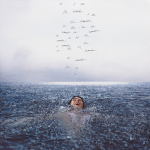 The Wonder album cover features Mendes afloat in a body of water.