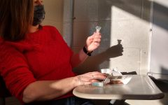 English teacher Ms. Calli Olson takes her saliva test on Thursday morning.