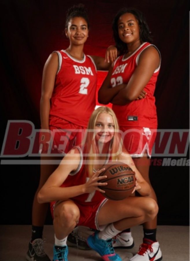 The girl's basketball captains, Sophie Coleman, Lindsey Layton, and Olivia Olson.
